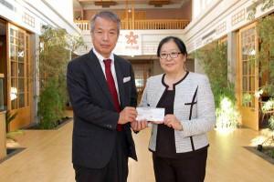 President Toshiaki Maruoka and Pamela Waintraub presentation of donation of $5,000